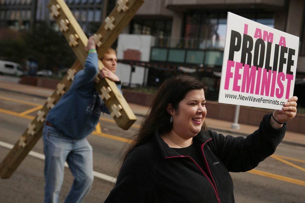 Rachel Lamb, of Richardson, Texas, who is part of the group New Wave Feminists, speaks to a marcher before the start of the Dallas Women's March in Dallas Saturday January 20, 2018. After the Dallas Women's March she participated in the North Texas March for Life. The march started at St. Paul United Methodist Church and ended at Pike Park in Uptown. Three marches took place in Dallas on Saturday, including the North Texas March for Life, Dallas Women's March and the Impeach Trump Solidarity Rally & March. (Andy Jacobsohn/The Dallas Morning News)