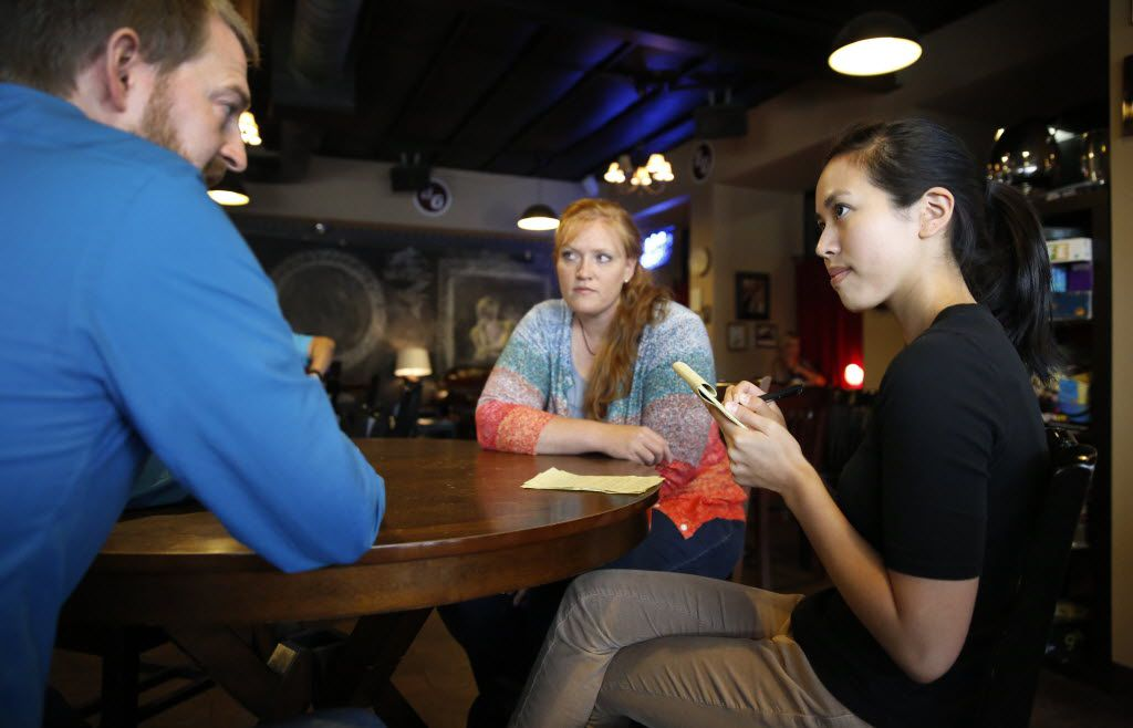 Dallas Morning News intern Naomi Nishihara (right) interviews Ebola survivor Dr. Kent Brantly and his wife Amber at the Buon Giorno Coffee in downtown Fort Worth, Tuesday, July 7, 2015.