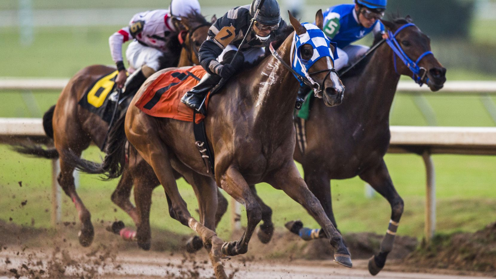 Jockey Domingo Chacaltana on Dixieland Paradise (7) pulls ahead of jockey David Cabrera on Sensational Appeal (5) and jockey C.J. McMahon on Expand the Moment (6) during race 3 on Thursday, April 9, 2015 at opening day at Lone Star Park in Grand Prairie, Texas.