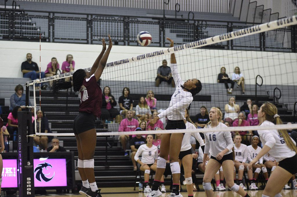 Denton Guyer's Jordyn Williams (7) spikes the ball during a match against Wylie in 2017. (Jake King/Denton Record-Chronicle)