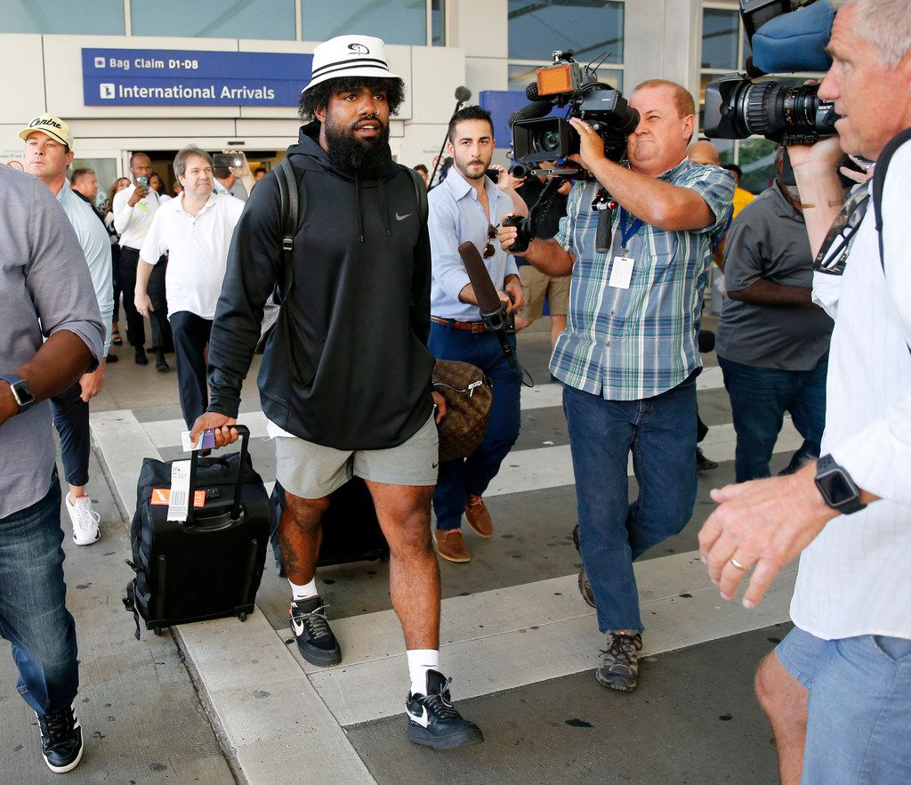 Dallas Cowboys running back Ezekiel Elliott arrives through customs at Dallas Fort Worth International Airport after arriving back from Mexico, Tuesday, September 3, 2019. Elliott has been holding out for a new contract from the Cowboys. (Tom Fox/The Dallas Morning News)