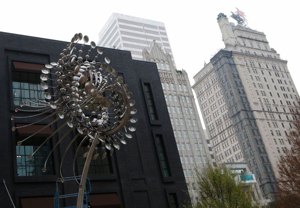 """Anthony Howe's kinetic wind sculptor, """"Lucea,"""" at the Forty Five Ten on Main fashion emporium in downtown Dallas, will debuts on November 12, 2016. Lucea is made of stainless steel, 22'h x 11'w x 8'd 6.7m h x 3.35m w x 2.4m d, 1000lbs. It will spin in ultra light winds but overbuilt to withstand strong. Photo taken on Friday, November 4, 2016. (David Woo/The Dallas Morning News"""