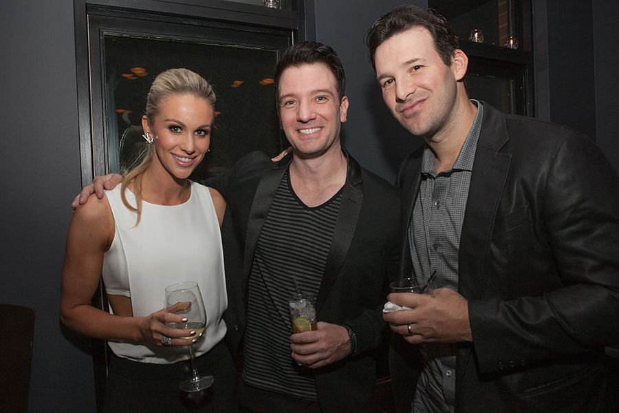"""WASHINGTON, DC - APRIL 24: (L-R) Candice Crawford, JC Chasez, and Tony Romo attend """"The Evening Before""""- a pre-White House Correspondents' Dinner party hosted by Eric Podwall and Spotify at Chaplin's Restaurant on April 24, 2015 in Washington, DC. (Photo by Teresa Kroeger/Getty Images for Eric Podwall)"""