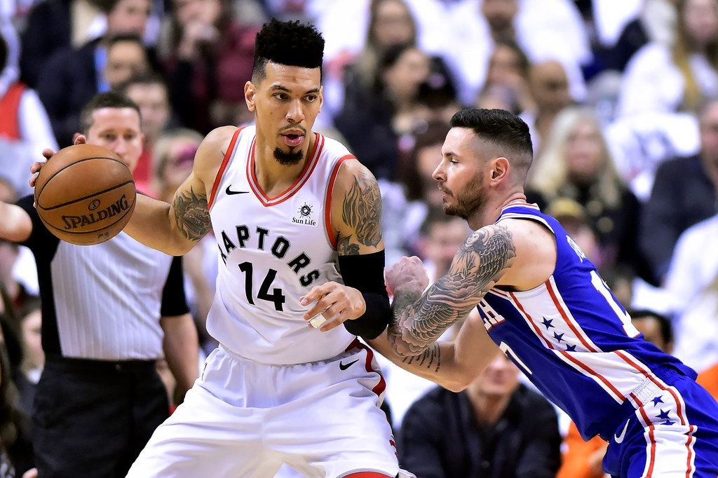 Philadelphia 76ers guard JJ Redick (17) tries to block Toronto Raptors guard Danny Green (14) during the first half of Game 1 of a second round NBA basketball playoff series, in Toronto on Saturday, April 27, 2019. (Frank Gunn/The Canadian Press via AP)