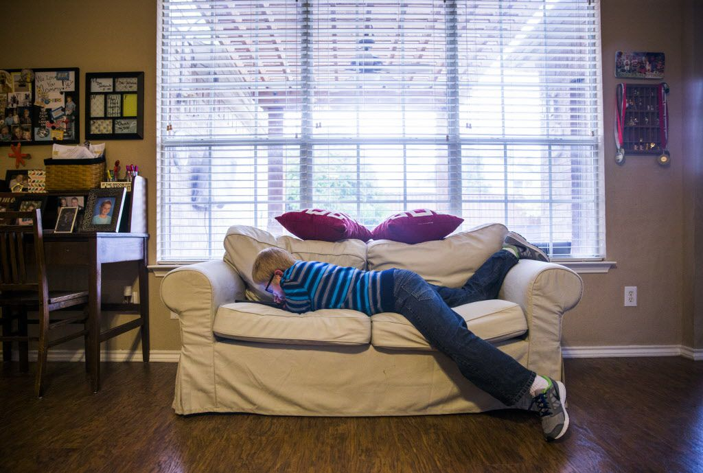 Ben Schneider, 11, watches YouTube videos on an iPad in his home on Tuesday, April 12, 2016 in Frisco. Schneider is autistic, has impaired vision and has cerebral palsy.  He will have the chance to meet his favorite musician, Ben Folds, on Thursday when he performs at The Majestic. (Ashley Landis/The Dallas Morning News)