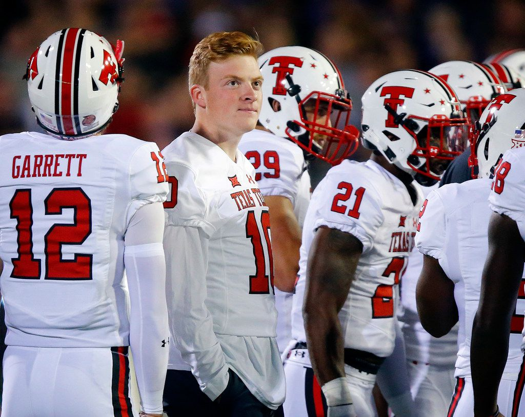 FILE - Texas Tech quarterback Alan Bowman (10) didn't dress for the game against TCU because he was injured.  He's pictured above during a first-half timeout at Amon G. Carter Stadium in Fort Worth on Thursday, Oct. 11, 2018. (Tom Fox/The Dallas Morning News)