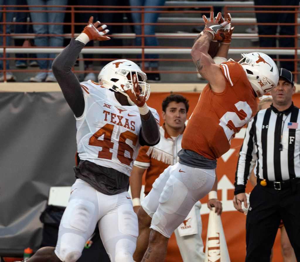University of Texas running back Kyle Porter (21) can not hold onto a pass in the end zone as linebacker Joseph Ossai (46) defends during the Orange and White spring game held at Darrel K Royal Texas Memorial Stadium on Saturday, April, 13, 2019, in Austin, Texas.  (Rodolfo Gonzalez/ Special Contributor)