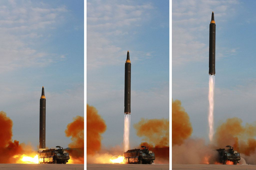 "This undated combination picture released from North Korea's official Korean Central News Agency (KCNA) on September 16, 2017 shows a launching drill of the medium-and-long range strategic ballistic rocket Hwasong-12 at an undisclosed location. Kim vowed to complete North Korea's nuclear force despite sanctions, saying the final goal of his country's weapons development is ""equilibrium of real force"" with the United States, state media reported on September 16."