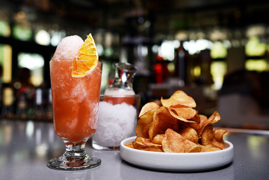 The negroni snow cone cocktail with giardiniera-dusted potato chips.