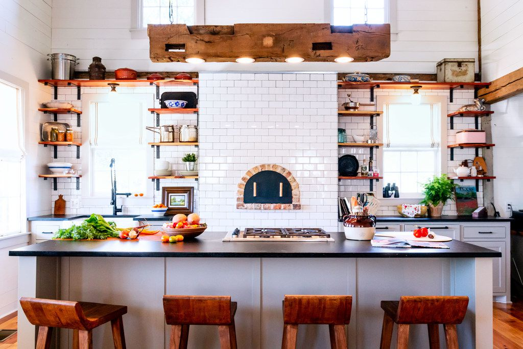 Bar stools provide a front-row seat to all the action in the kitchen, which is sure to attract a crowd, says Tara Lenney.