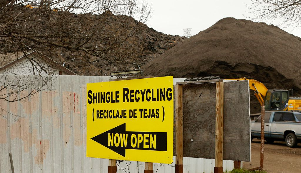 A large hill of recycled shingles is seen at Blue Star Recycling near State Highway 310 and Interstate 20 in southern Dallas.