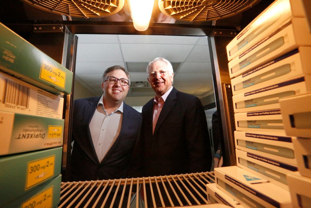 Will Howard (left), president, and Win Purifoy, chairman of Senderra Specialty Pharmacy, are framed by some of the drugs they dispense in their Richardson business. They sell high-end drugs, most of which are kept refrigerated and shipped in insulated packages. (Ron Baselice/Staff Photographer)