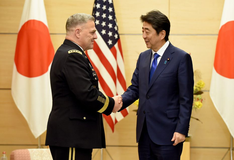 U.S. Army Chief of Staff Gen. Mark Milley (left) visit with Japanese Prime Minister Shinzo Abe in Tokyo in September. Milley plans to attend the Greater Dallas Veterans Day Parade on Nov. 10.