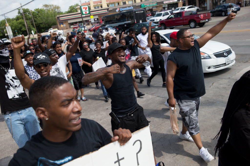 Black Lives Matter protestors march down Park Ln on July 10, 2016 in Dallas. (Ting Shen/The Dallas Morning News)