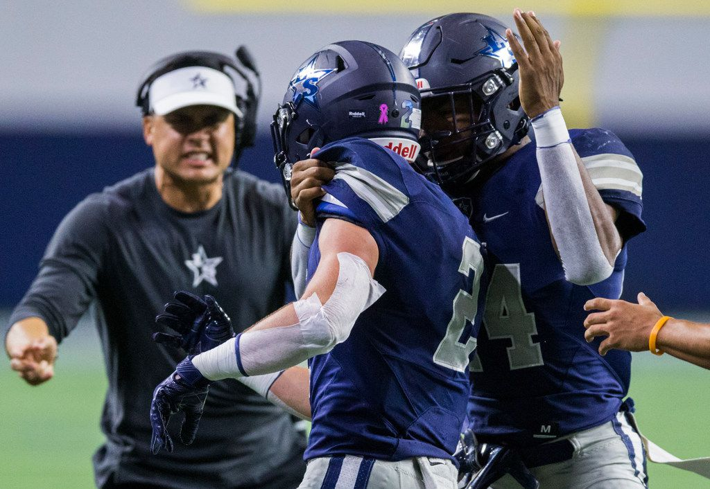 Frisco Lone Star wide receiver Jake Bogdon (2) celebrates a touchdown with quarterback Dylan Deleon (14) during the first quarter of a District 5-5A Division I high school football game between Frisco Independence and Frisco Lone Star on Thursday, October 10, 2019 at the Ford Center at The Star in Frisco. (Ashley Landis/The Dallas Morning News)