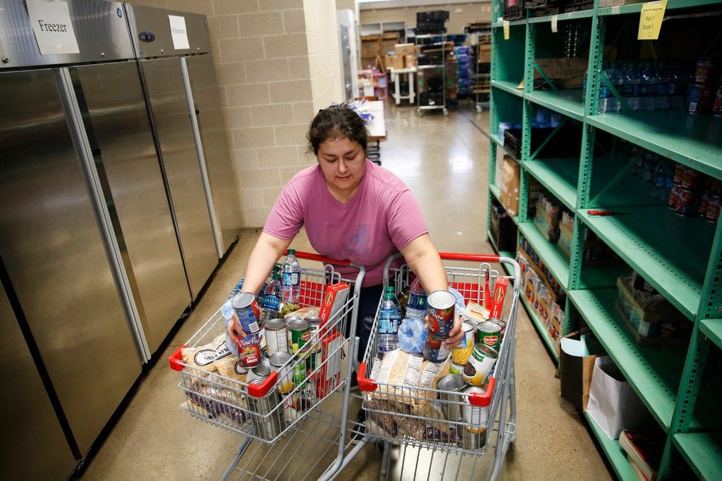 Volunteer Sulin Martinez helps pack meals for deliver to the elderly and homebound at Brother Bill's Helping Hand in Dallas.
