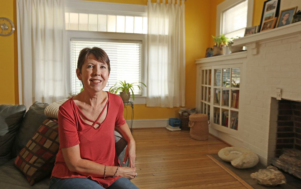 Cancer survivor Angela Turnage is pictured at her home in Dallas. Her last treatment for ovarian cancer was Halloween, 2013.