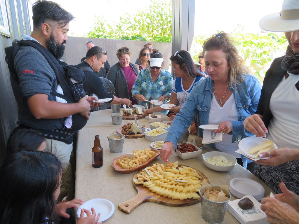 After a tour of Point Reyes Farmstead Cheese Co., visitors get to sample the company's cheeses plus some other snacks.