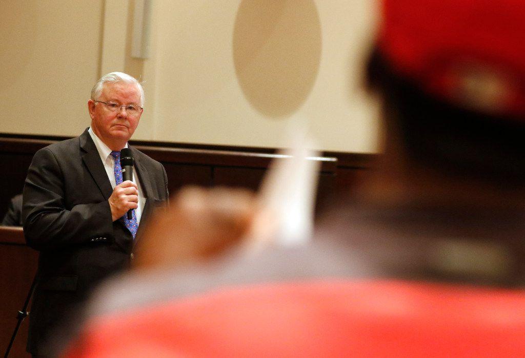 Texas Republican Congressman Joe Barton listens as Chuck Dandridge asks questions during a town hall meeting at Mansfield City Hall on April 13, 2017.