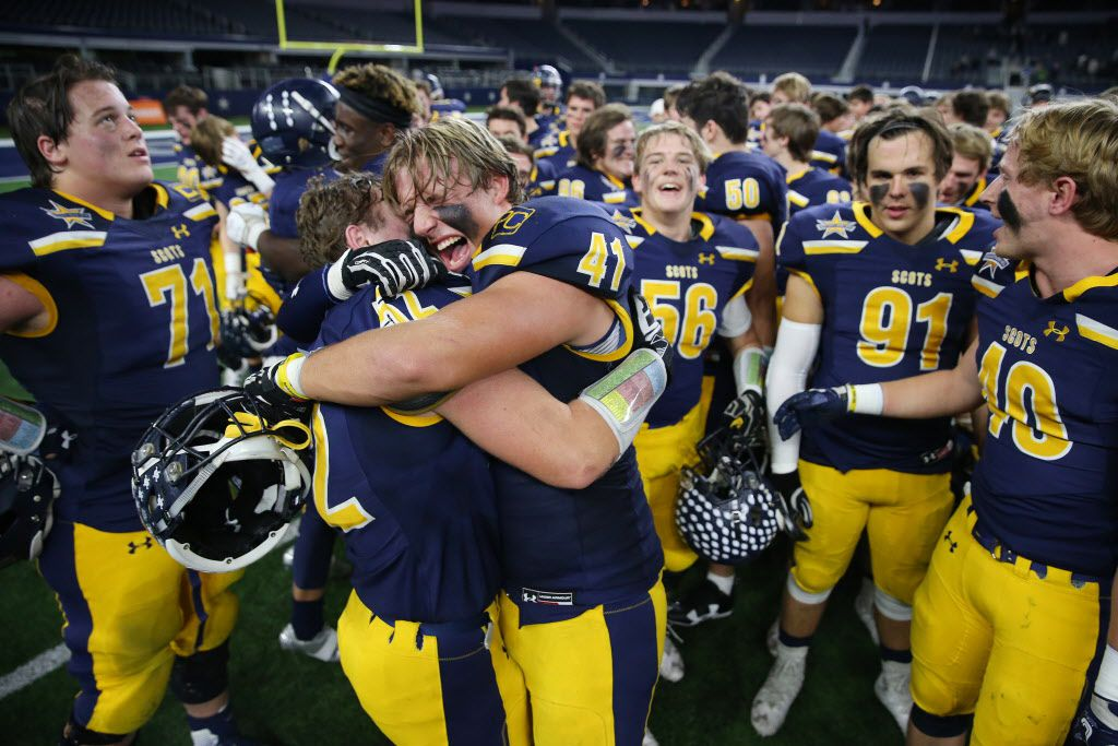 Highland Park teammates Elliott Newsom (41) and Ben Boudreaux (52) celebrate following the Class 5A Division I Region II final playoff high school football game between Highland Park and Mansfield Lake Ridge at AT&T Stadium in Arlington, Texas Friday December 8, 2017. Highland Park beat Mansfield Lake Ridge 37-35. (Andy Jacobsohn/The Dallas Morning News)