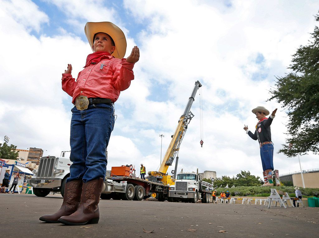 Brody Balda, 8, of Fort Worth, adopts the pose of Big Tex as crew workers finished lifting Big Tex into place in Fair Park in Dallas, Friday, Sept. 22, 2017. For 2018, the State Fair of Texas will open Sept. 28 and run through Oct. 21.