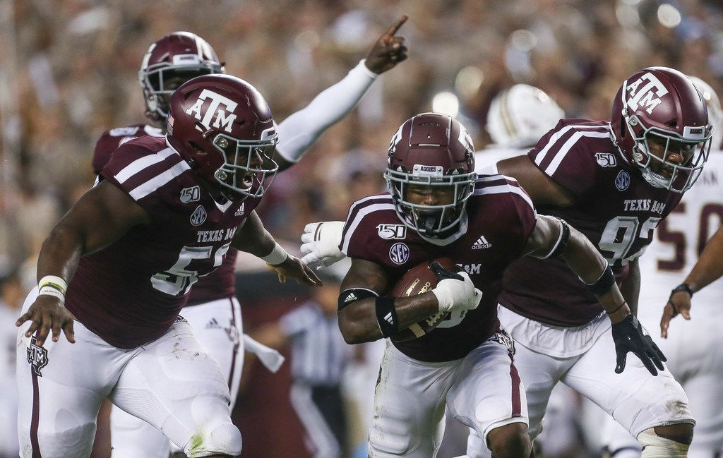 Texas A&M Aggies defensive back Leon O'Neal Jr. (9), middle, celebrates with defensive lineman Justin Madubuike (52), left, and defensive lineman Jayden Peevy (92), right after making a play during the first quarter of a college football game between Texas A&M and Texas State on Thursday, Aug. 29, 2019 at Kyle Field in College Station.
