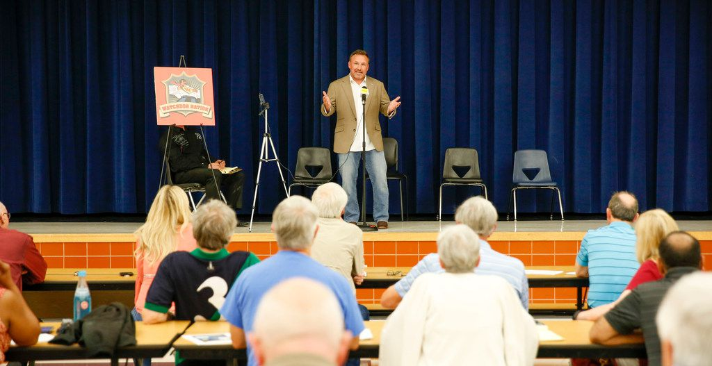 Will Wiggins of North Texas Property Tax Services speaks to a crowd at a property tax seminar held by The Watchdog.