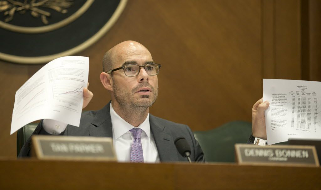 Rep. Dennis Bonnen, Chair of the House Ways and Means Committee, shows some documents during a hearing on Senate Bill 1 at the Capitol on Tuesday May 12, 2015.  JAY JANNER / AMERICAN-STATESMAN