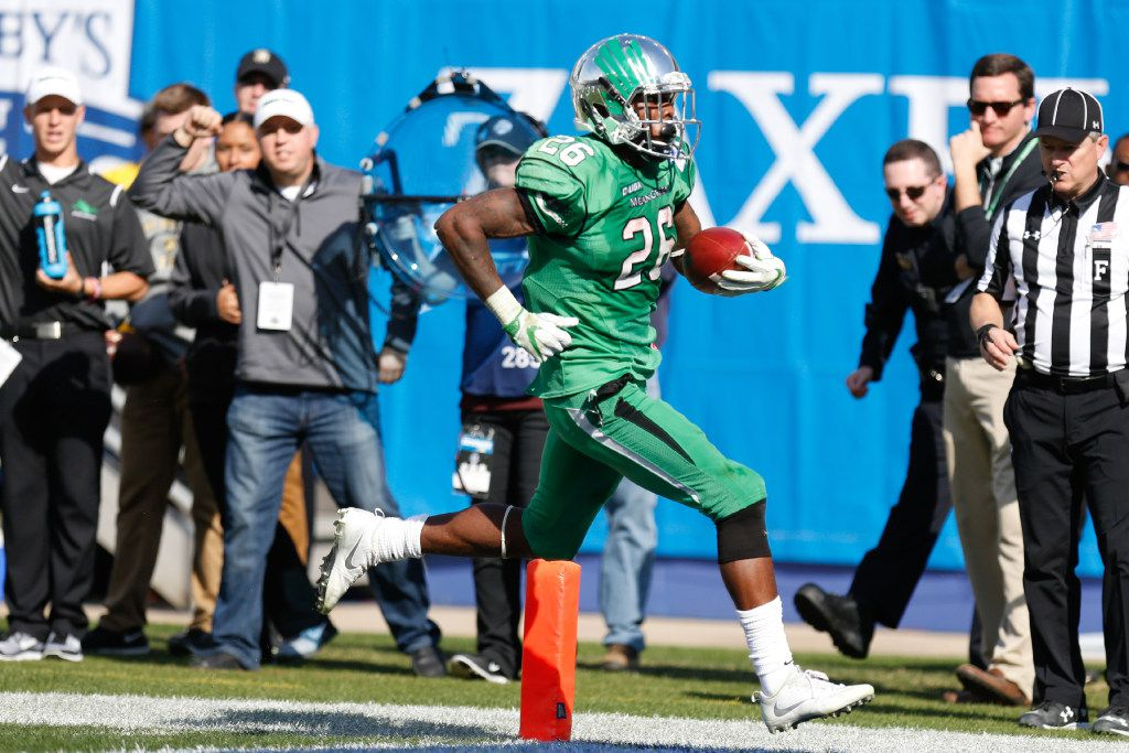 North Texas junior running back Jeffery Wilson (26) rushes in for the touchdown against the Army defense at Cotton Bowl Stadium, Tuesday, December 27, 2016, in Dallas, Texas, Jeff Woo/DRC