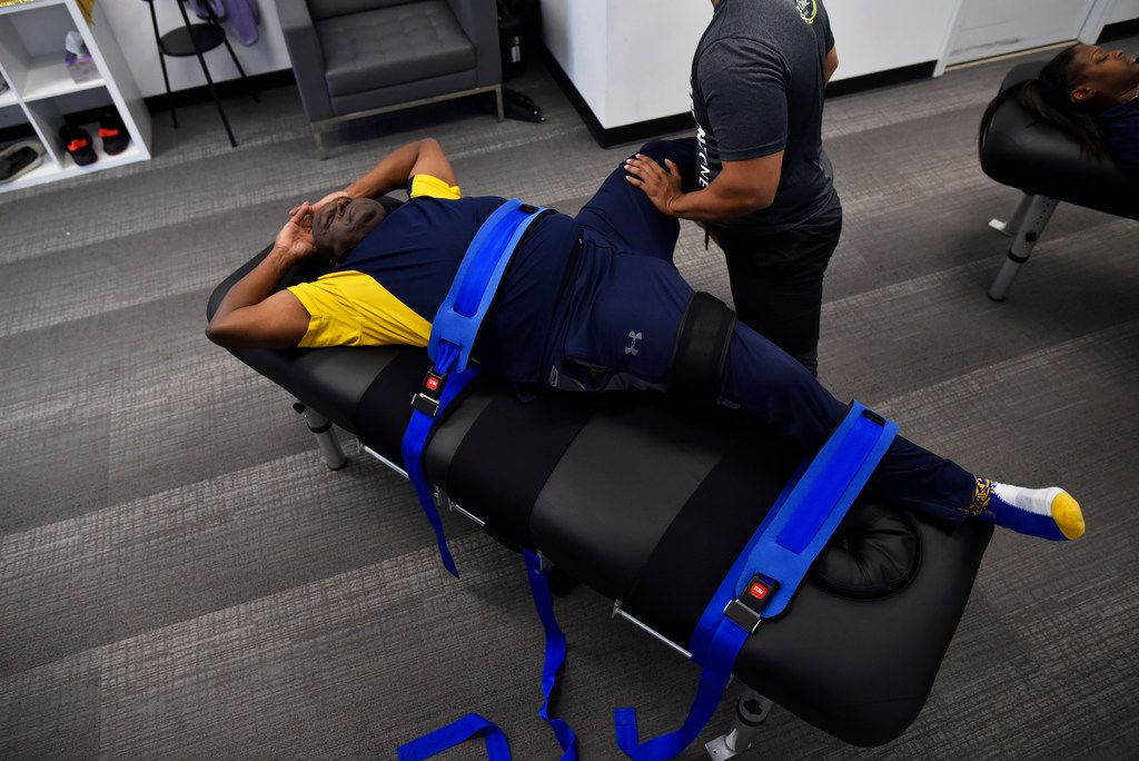 Stretch practitioner Shan Hussain works on client Sergeant Nathan Wilson, of the Dallas County Sheriff Department, as Hussain pushes and pulls Wilson's limbs during a session at Stretch Zone in Dallas, Wednesday, March 13, 2019. Ben Torres/Special Contributor