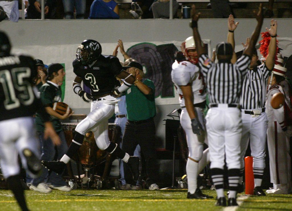 Friday, September 19, 2003: Referees signal a touchdown as Richardson Berkner receiver Aqib Talib (3) celebrates pulls down a 25 yard TD pass with seconds left in the first half against Irving MacArthur at Wildcat-Ram Stadium. (Tom Fox/The Dallas Morning News)