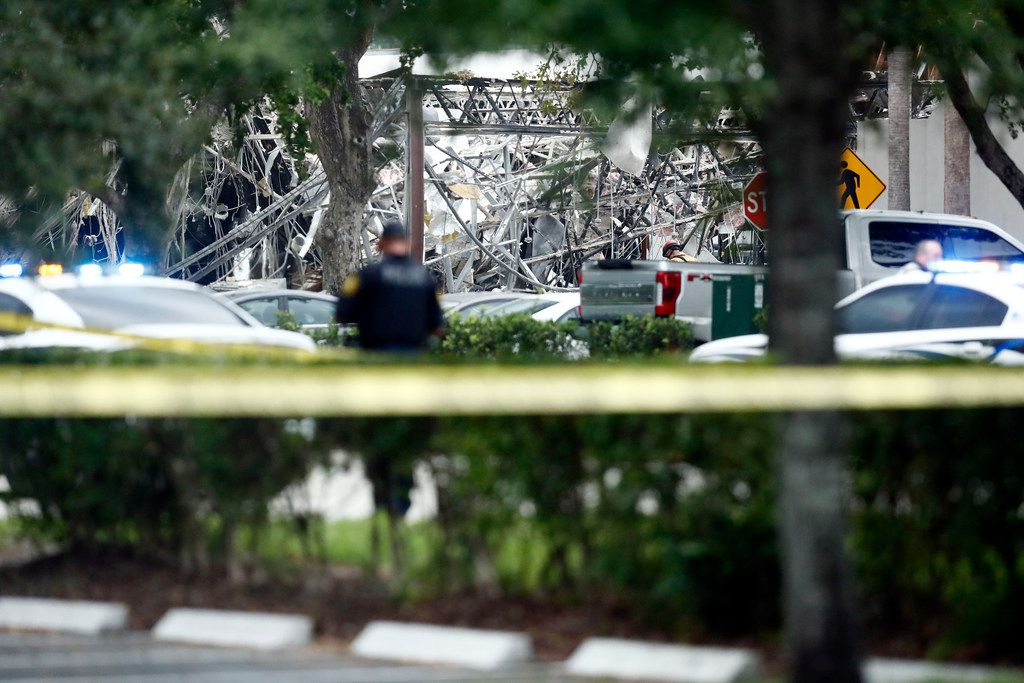 A police officer guards the area after an explosion Saturday in Plantation, Fla.  Several people were injured after a vacant pizza restaurant exploded in the South Florida shopping plaza, according to police.  The restaurant was destroyed, and nearby businesses were damaged.