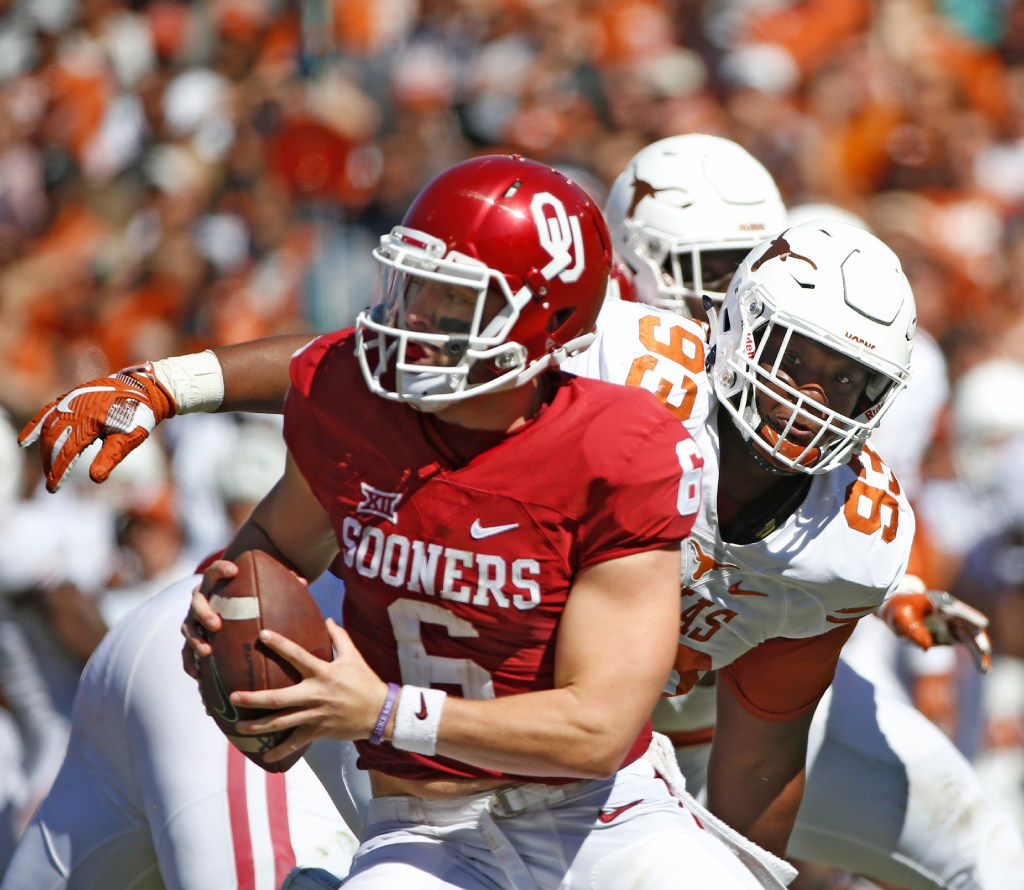 Texas Longhorns defensive tackle Paul Boyette Jr. (93) rushes DUPLICATE***Oklahoma Sooners quarterback Baker Mayfield (6) in the first half of the Red River Showdown at the Cotton Bowl in Dallas, TX Oct. 8, 2016.   (Nathan Hunsinger/The Dallas Morning News)