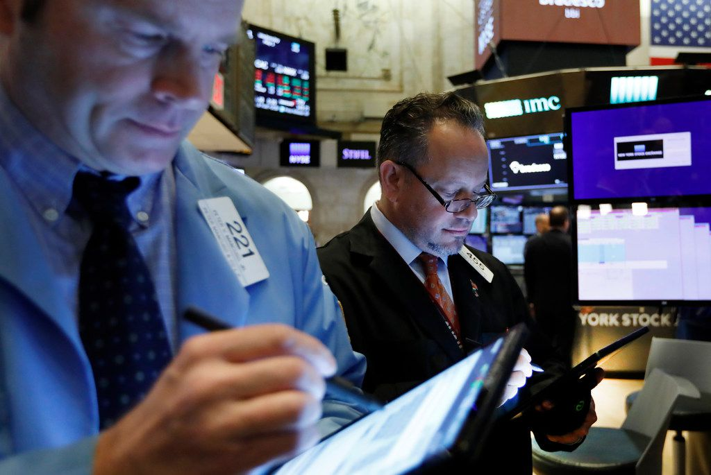 Traders work on the floor of the New York Stock Exchange. in May.  Don't buy stocks just because an analyst recommends it, the Fool says.