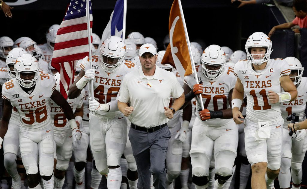 Texas head coach Tom Herman, center, takes the field with his team before Texas' 48-13 win over Rice on Saturday, Sept. 14, 2019, in Houston.