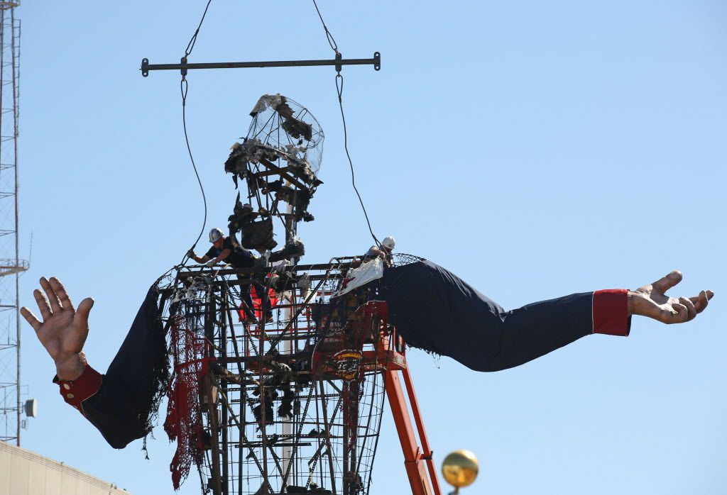 2012 Workers anchor a crane hoist to Big Tex for his removal after a fire took him down to his frame at the State Fair of Texas in Dallas October 19, 2012. (Nathan Hunsinger/ Staff Photographer)   --  MANDATORY CREDIT, NO SALES, MAGS OUT, TV OUT, INTERNET USE BY AP MEMBERS ONLY
