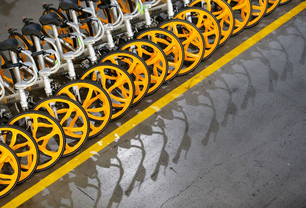 A row of assembled VBikes, a rent-a-bicycle via downloadable app, are lined up at Massimo in Garland, Texas, Thursday, September 7, 2017. The stationless bike sharing cycles that come unassembled from China, are put together in the warehouse and those that are in disrepair are brought in from the field to be fixed. (Tom Fox/The Dallas Morning News)