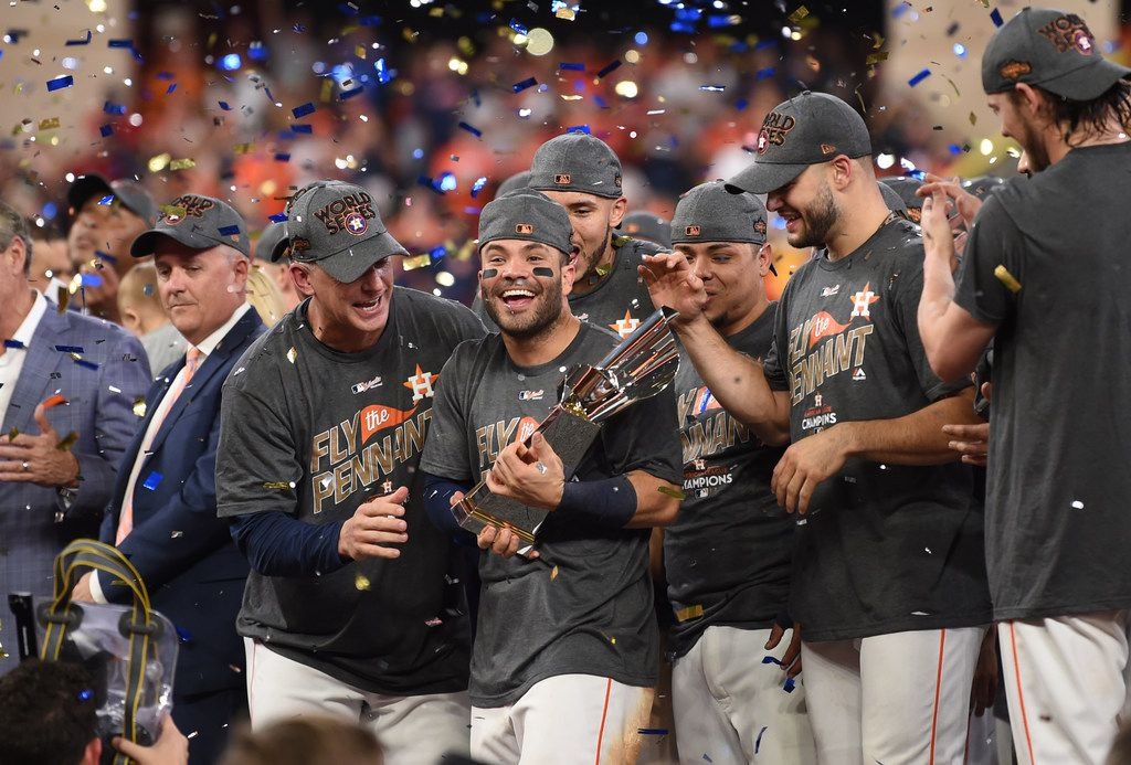 Jose Altuve (center) and the Houston Astros celebrate winning the pennant with a 4-0 win over the New York Yankees in Game 7 of the American League Championship Series on Saturday.