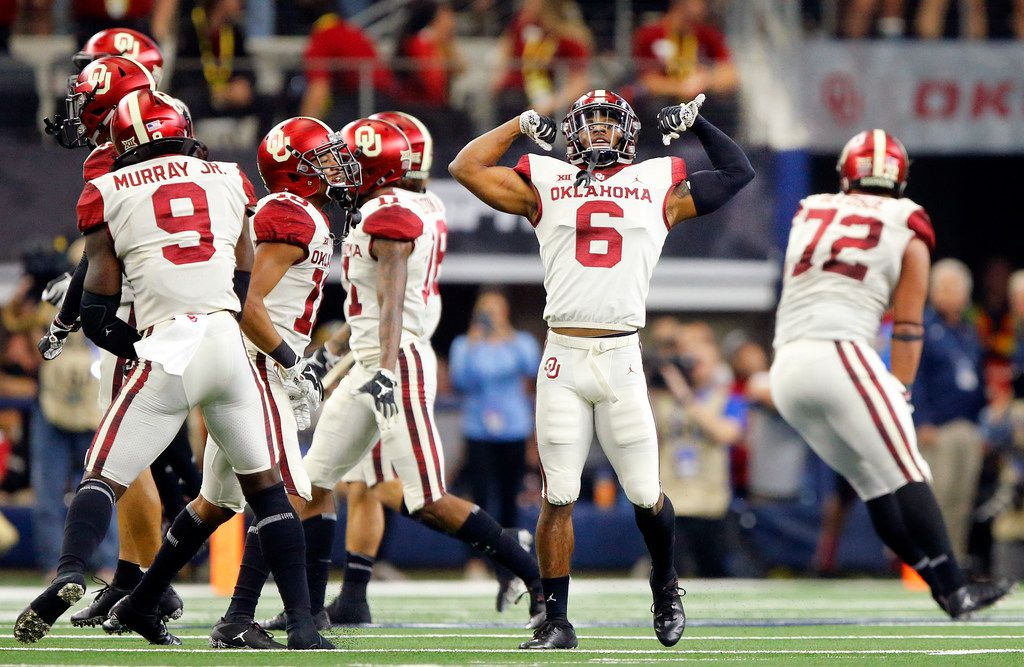 Oklahoma Sooners cornerback Tre Brown (6) flexes his muscles after his sack and safety of Texas Longhorns quarterback Sam Ehlinger during the fourth quarter of the Big 12 Championship at AT&T Stadium in Arlington, Texas, Saturday, December 1, 2018. The Sooners defeated the Longhorns, 39-27.