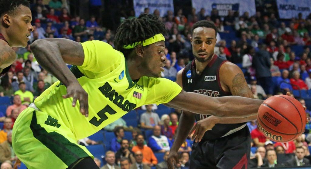 Baylor Bears forward Johnathan Motley (5) grabs a loose ball in the second half during the Baylor Bears vs. the New Mexico State Aggies NCAA basketball game at the BOK Center in Tulsa, Oklahoma on Friday, March 17, 2017. (Louis DeLuca/The Dallas Morning News)