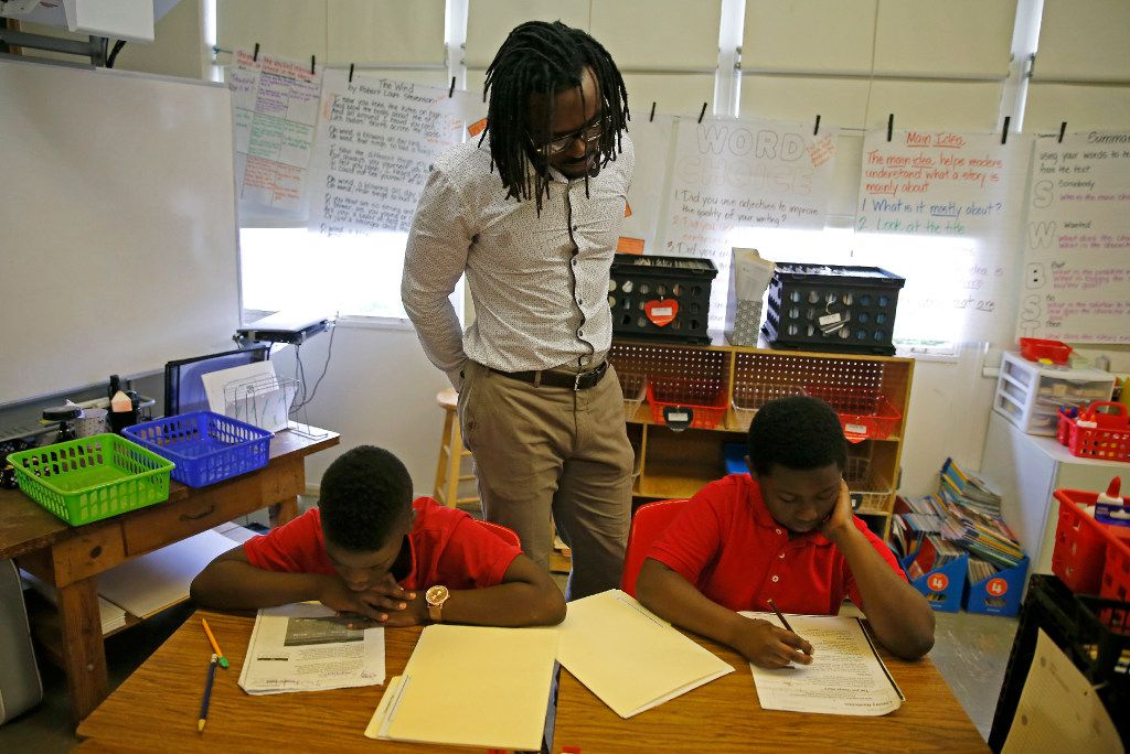 Dallas Cowboys cornerback Brandon Carr (center) watches fourth graders Akyden Adams (right) and Roy Washington in a reading class at Mark Twain Leadership Vanguard in Dallas, Monday, Oct. 17, 2016. Carr participated in Dallas Independent School District's Principal for a Day program that brings community leaders into schools serving as a principal for a day across the district. (Jae S. Lee/The Dallas Morning News)