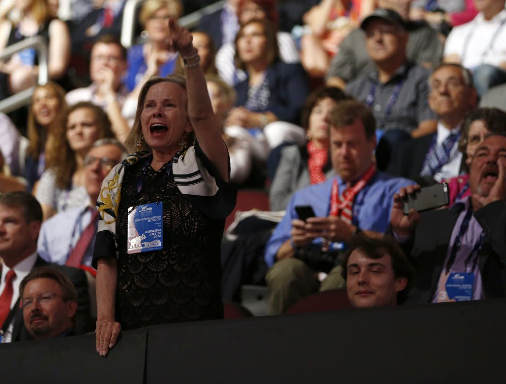 A woman yells for Ted Cruz to say he's backing Donald Trump during his speech at the Republican convention last month in Cleveland.