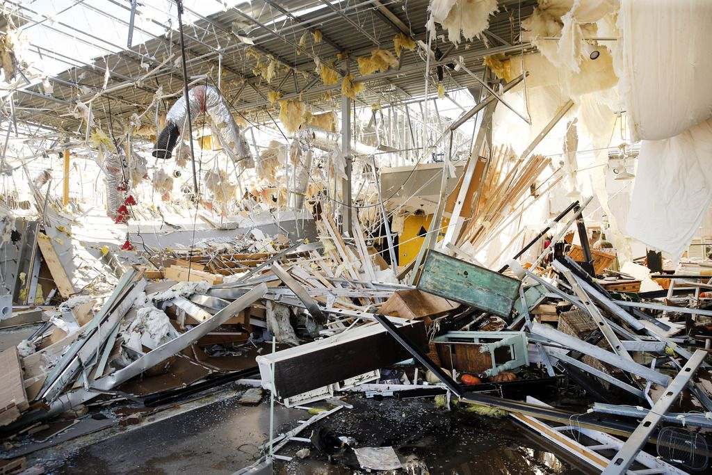 It looks as it a bomb went off in the Talbots, Interabang Books store and SampleHouse Candleshop in the Preston Royal shopping center  in Dallas, Monday, October 21, 2019. A tornado tore through the entire shopping center. (Tom Fox/The Dallas Morning News)