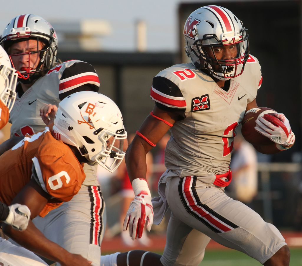 Flower Mound Marcus running back Justin Dinka (2) carries for a first down as Arlington Bowie safety Jordan Lane (6) defends during a first half rush. Arlington Bowie and Flower Mound Marcus opened their 2017 football campaign in their Class 5A season opener at Wilemon Field in Arlington on August 31, 2017. (Steve Hamm/Special Contributor)