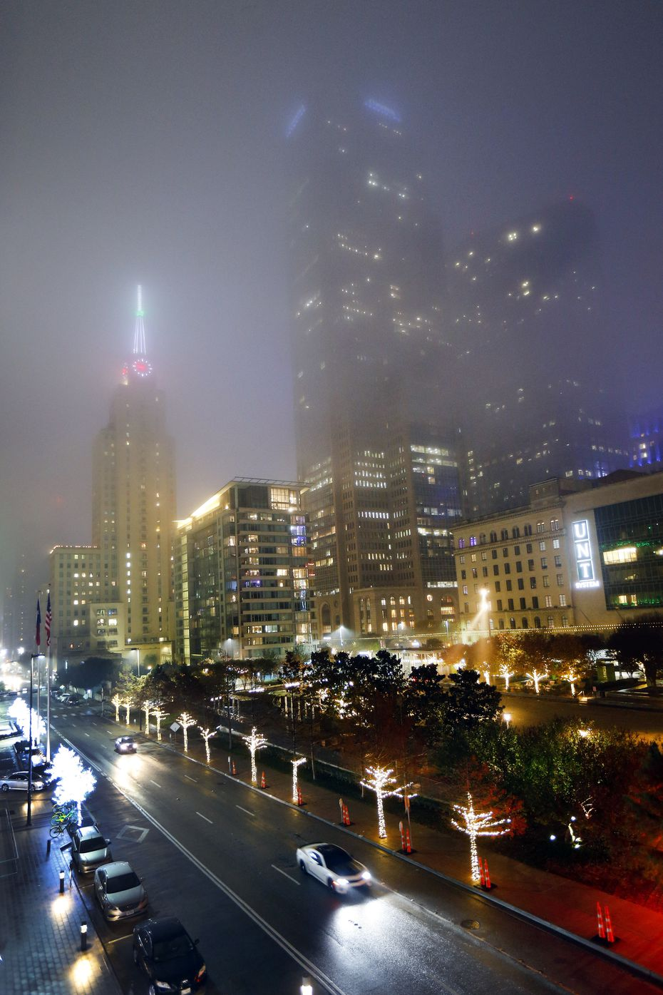 Fog settled over the historic Mercantile Building (left) and Comerica Bank Tower (center) and Main Street Garden Park in downtown Dallas on Monday evening.