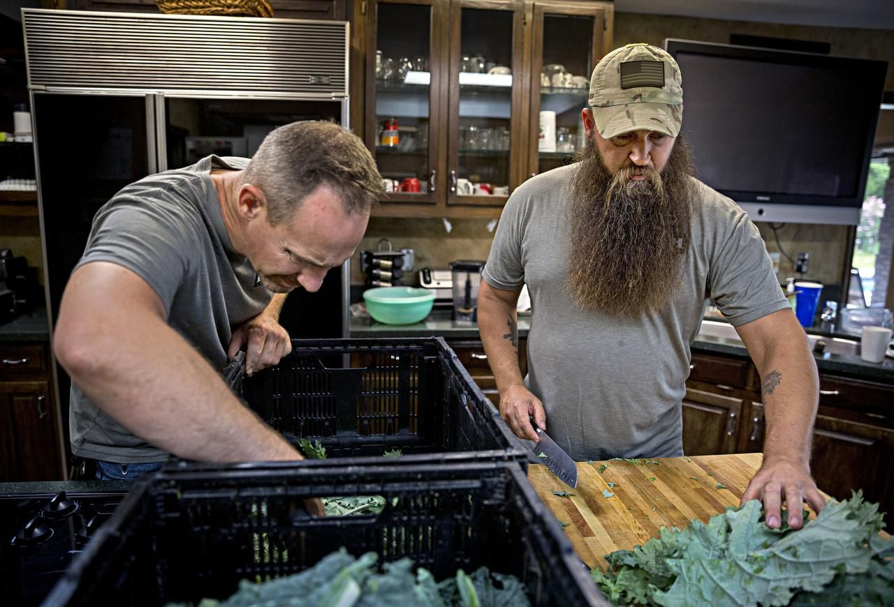 Stephen Smith  (left) and James Jeffers grow kale and other produce on a farm in DeSoto. Farmers Assisting Returning Military strives to help military veterans and, hopefully, decrease veteran suicides.