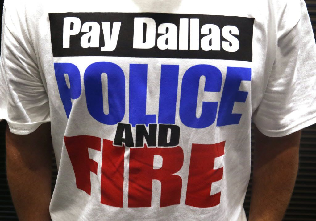 Dallas police officers, first responders and their supporters attended a meeting at Dallas City Hall asking for a raise on Aug. 3, 2016.
