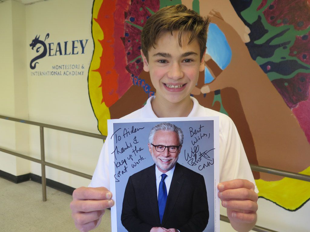 Aiden Ross, an eighth grade student at George Bannerman Dealey International Academy received a headshot and note from his hero, Wolf Blitzer, Thursday after he won a district-wide essay contest.