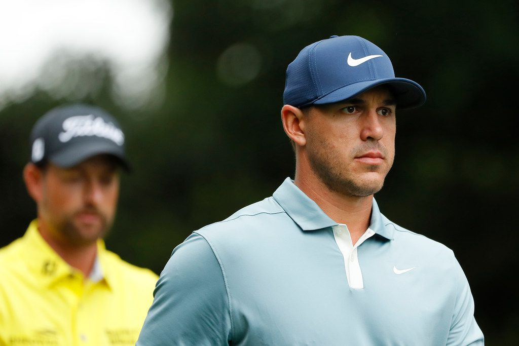 AUGUSTA, GEORGIA - APRIL 14: Brooks Koepka and Webb Simpson of the United States walk on the second hole during the final round of the Masters at Augusta National Golf Club on April 14, 2019 in Augusta, Georgia. (Photo by Kevin C. Cox/Getty Images)