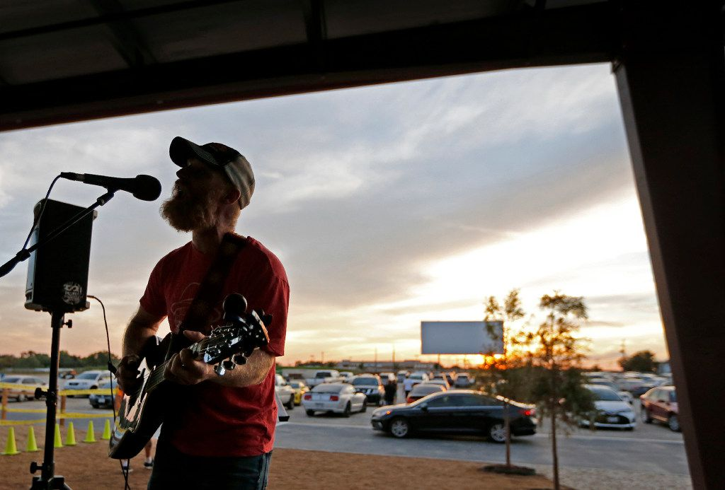 Joshua Irwin of Fort Worth entertains the crowd on the covered patio with some live music before the movies start at the Coyote Drive-In in Lewisville, Texas, photographed on Saturday, October 29, 2016. (Louis DeLuca/The Dallas Morning News)